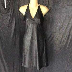 La Belle little black dress looks leather
